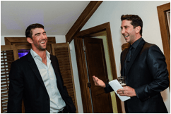 """Friends"" star David Schwimmer chatted with his pal, Olympian Michael Phelps, as he prepared to Emcee the Big Game Big Give event, sponsored by BBO Poker Tables"